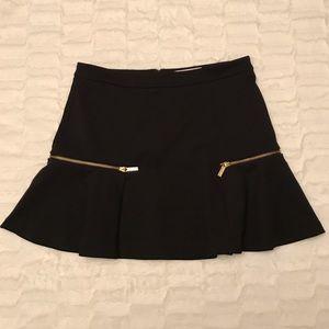 Michael Korda flirty skirt with gold zippers
